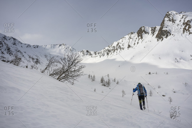 Man on an excursion in snowy mountains- Lombardy- Valtellina- Italy