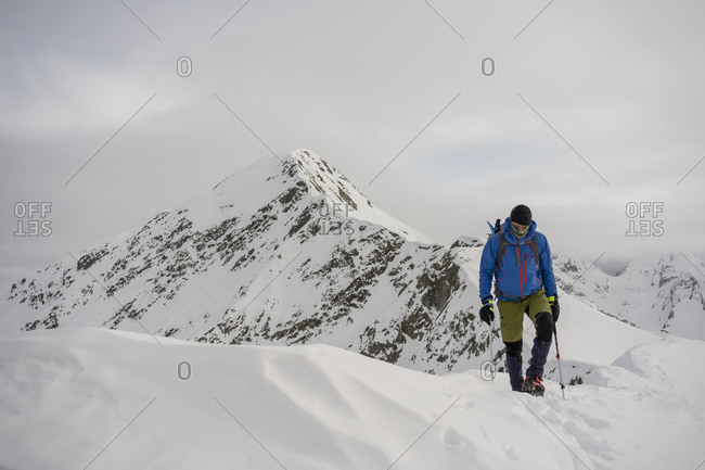 Man on an excursion on the crest of a snowy mountain- Lombardy- Valtellina- Italy