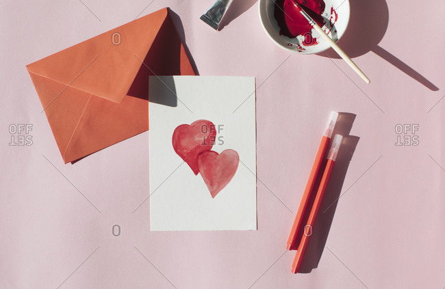 Making a Valetine's day card- red envelope and card with hearts