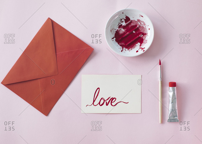 Making a Valetine's day card- red envelope and card with love written on it