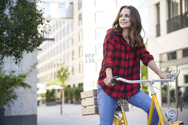 Brunette woman riding bicycle in the city