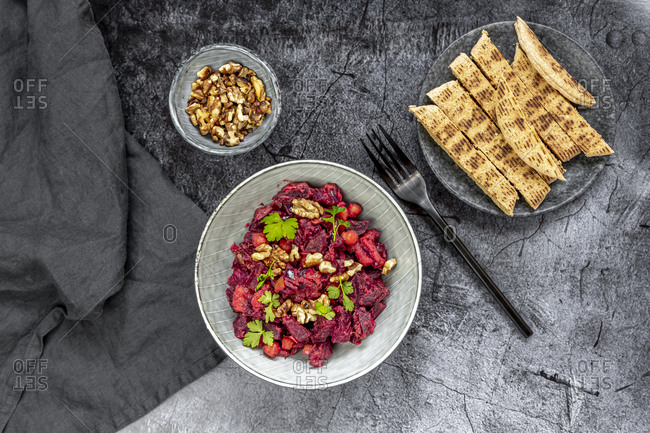 Pita bread and plate of beetroot salad with chick-peas- roasted walnuts and parsley