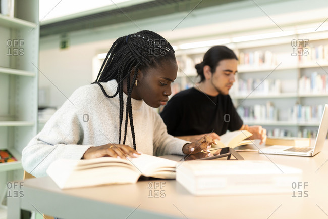 Two students learning in a library