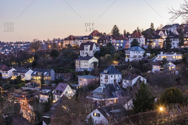 Germany- Baden-Wurttemberg- Stuttgart- Apartments and villas of hillside suburb at dusk