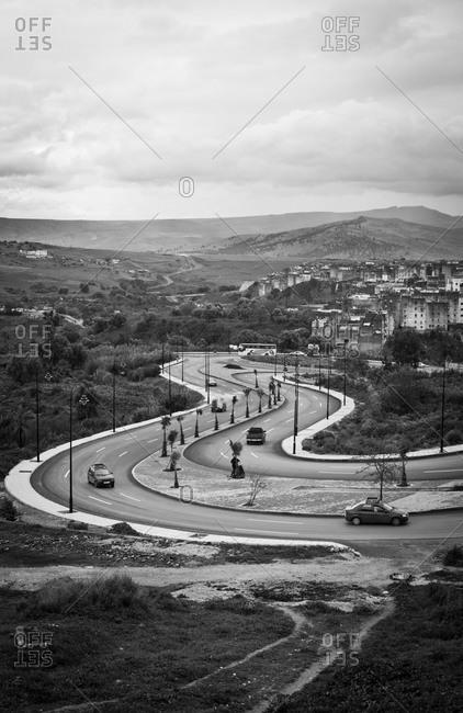 Cars travel a winding road outside Fes, Morocco