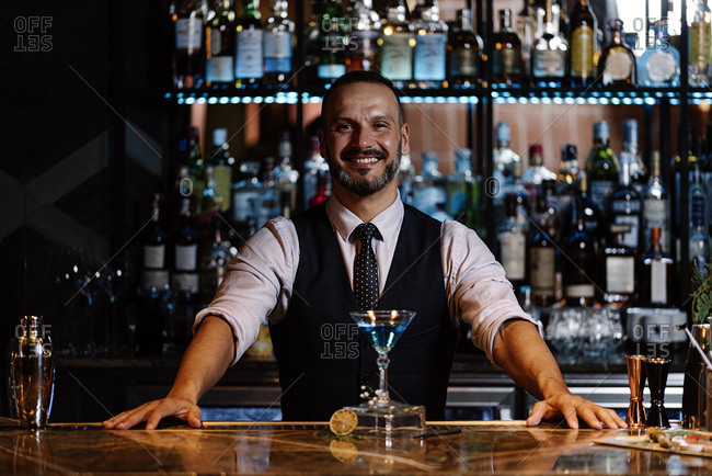 Stock photo of a portrait of an expert barman at night club.