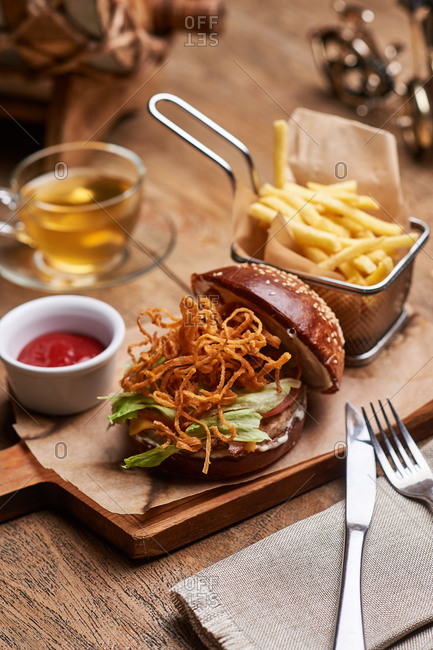 Burger with French fries and a glass of tea