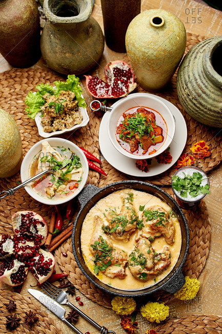 Georgian cuisine dishes of chicken khinkali with lamb soup, kharcho, and pomegranates