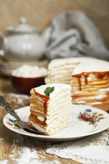 Multi layer honey cake with sour cream mint and chocolate mousse