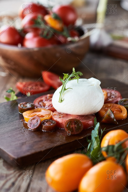 Burrata with vegetables and tomatoes