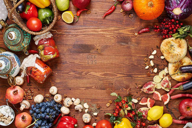 Market background frame on a dark wooden table made of fruits and vegetables pickles and bread tortillas