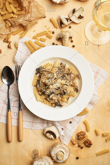 Pasta with mushrooms and walnuts on cream with parmesan and white wine
