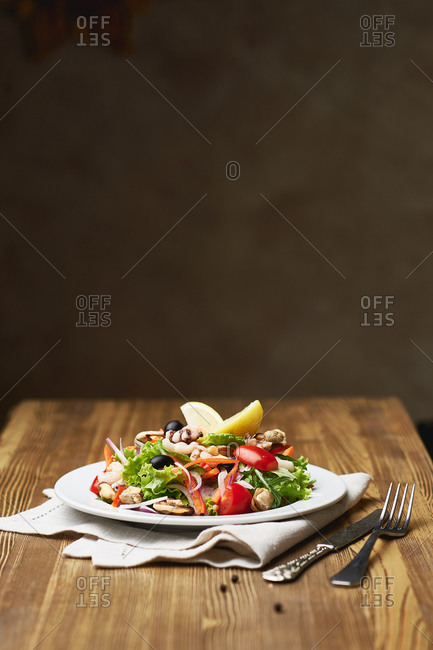 Fresh seafood salad with octopus, mussels, tomatoes onion lemon olive salad