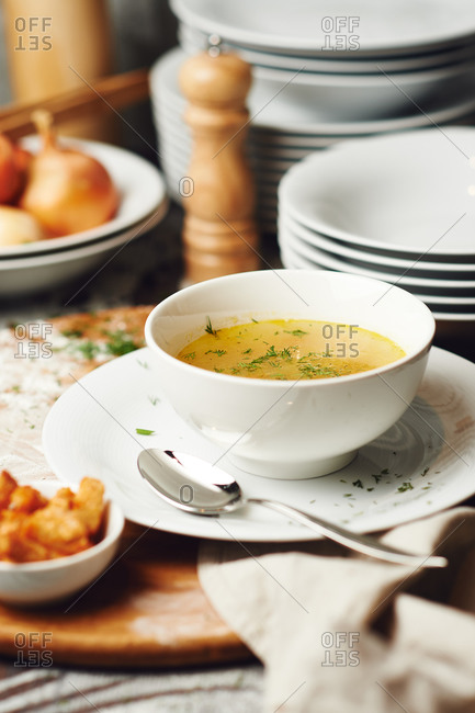 Chicken soup served with croutons
