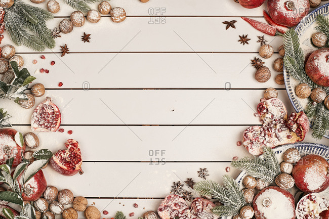 Wintry border composed of pomegranates and walnuts