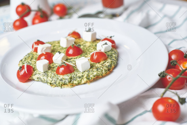 Breakfast omelet greens feta cheese and cherry tomatoes