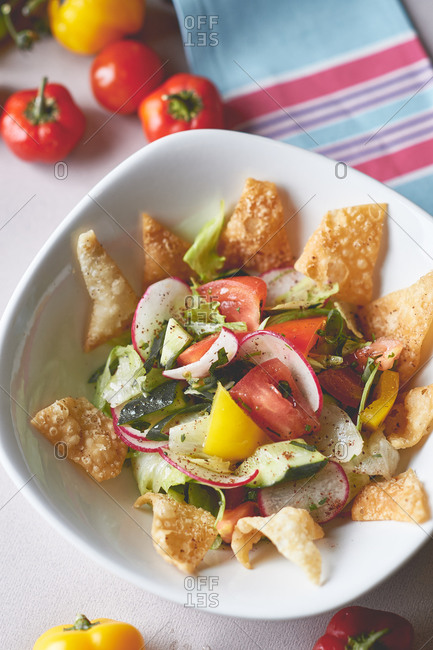 Fresh vegetable salad with butter and corn chips nachos