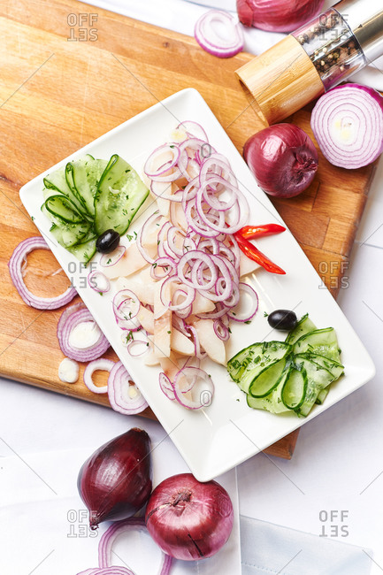Fresh fish in a white vinegar and spices with onions pepper and cucumber
