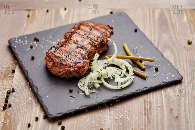 Grill steak of the best beef on a plate made of stone