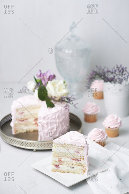 Beautiful cake with pink cream on a white background