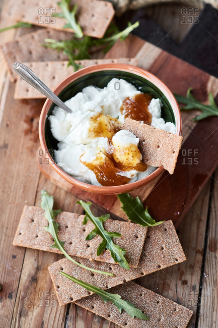 Fresh cottage cheese with figs and bread arugula