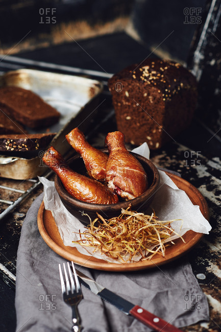 Smoked grilled chicken legs with black bread