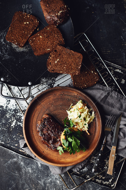 Grilled steak with butter and coleslaw salad