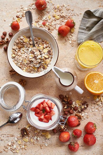 Oatmeal granola muesli with yogurt with strawberries and orange juice