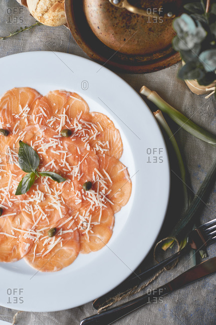Appetizer for beer salmon carpaccio with basil hazelnuts and parmesan cheese