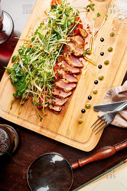 Tuna steak with fresh herbs and pesto parmesan cheese