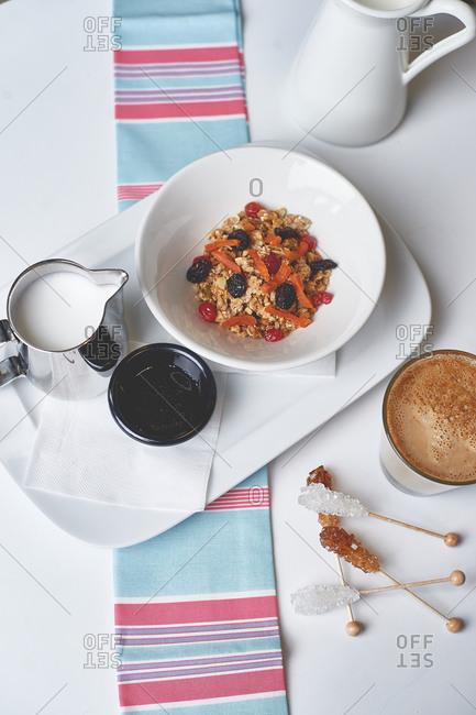 Oatmeal granola muesli with yogurt with strawberries and a cappuccino