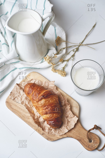 Fresh delicious French croissant made of puff pastry with country milk