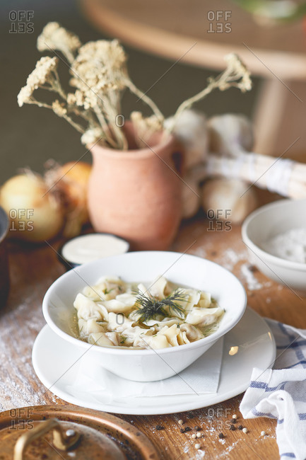 Meat dumplings in broth with dill, a Russian cuisine