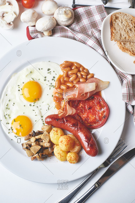 English breakfast served with a cappuccino