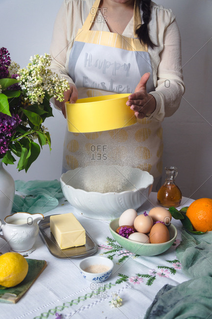 Woman sifting flour for Easter pinca bread