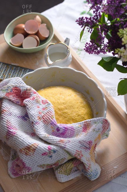Easter pinca bread proofing in a bowl