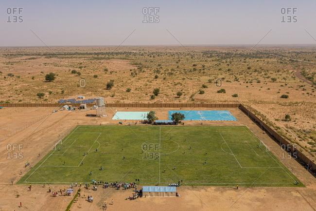 Libyan refugees playing football at a refugee camp in Hamdallaye, Niger