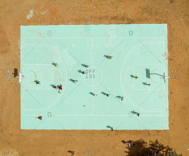 Drone view of Libyan refugees playing basketball at a refugee camp in Hamdallaye, Niger