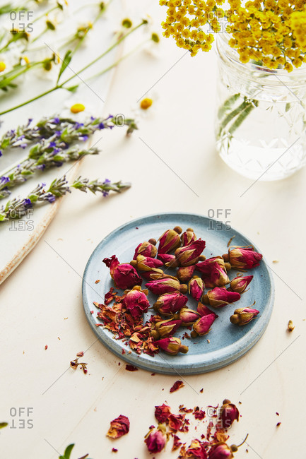 Dried rose buds on a ceramic plate