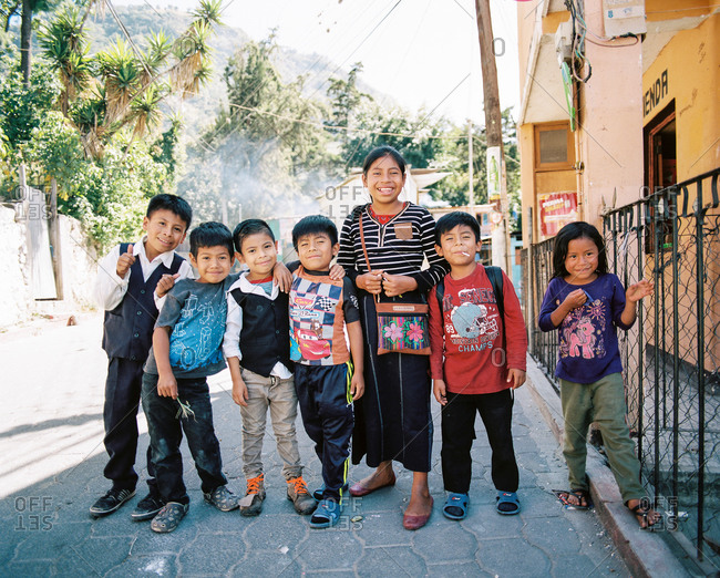 Guatemala - March 3, 2020: Young kids standing on city street in Guatemala
