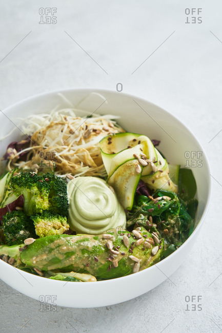 Close up of a healthy green salad on light background