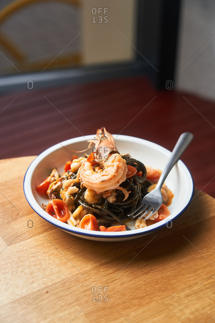 A seafood pasta dish on a table in a restaurant