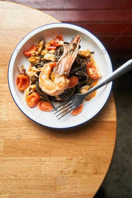 Top view of a seafood pasta dish on a table in a restaurant