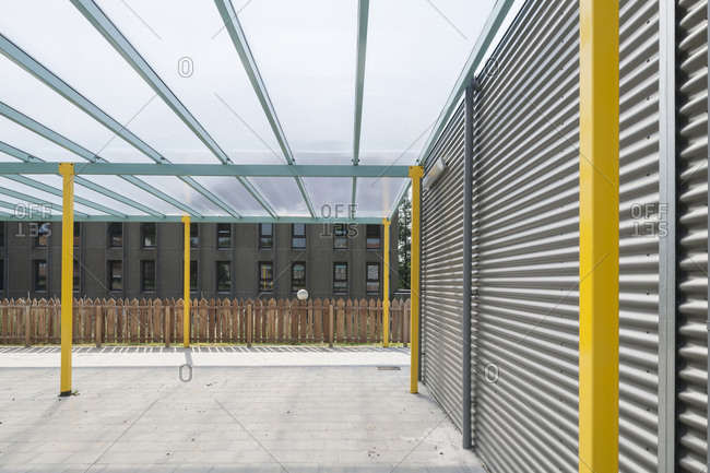 Modern school building exterior with a covered patio
