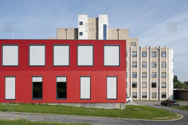 Bright red building exterior in Tongeren, Belgium