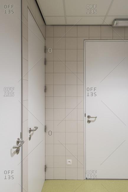 Three doors in the corner of a building interior
