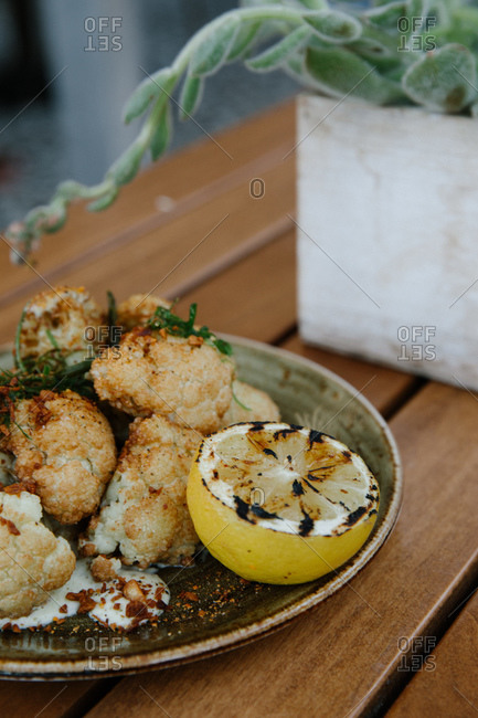 Fried cauliflower dish with served with lemon