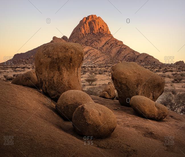 Sunrise at Little Spitzkoppe bald granite peak in Namibia
