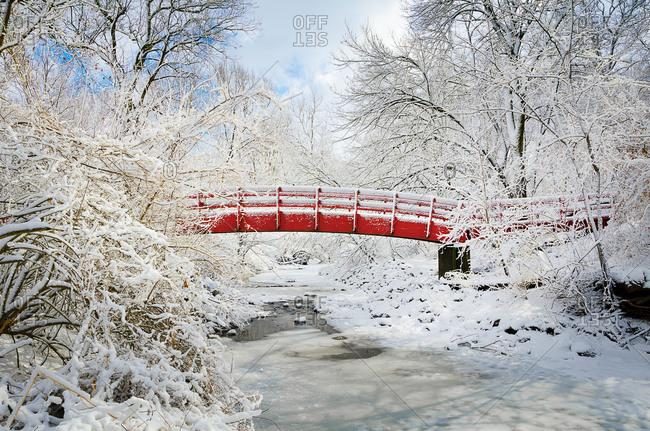 Fresh snowfall on red bridge
