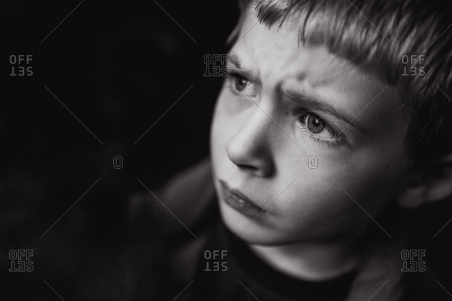 A little boy looks concerned.